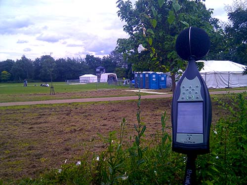 Picture of sound level meter monitoring noise at live event outdoors